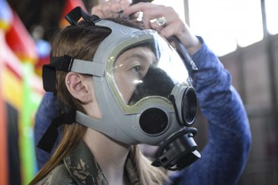 girl wearing gas mask military