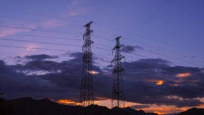 power towers electricity night sky