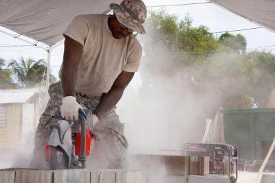 army sawing cinder blocks