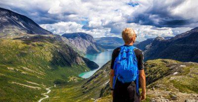 man backpack mountains hiking