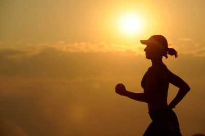 running woman jogging long distance sun