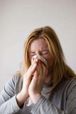 girl sick flu blowing nose