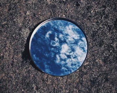 light-clouds-grass-ground-mirror