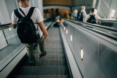 backpack-walking-down-subway