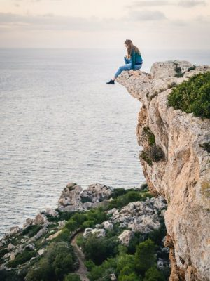 girl-on-cliff-looking-out