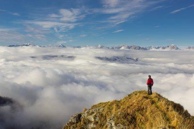 man standing on mountain hiker