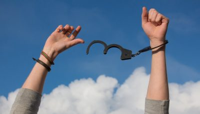 woman breaking out of handcuff