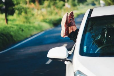 woman-feet-outside-of-car