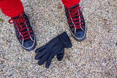 feet glove on floor