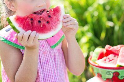 girl eating watermelon summer