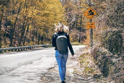 woman highway backpack