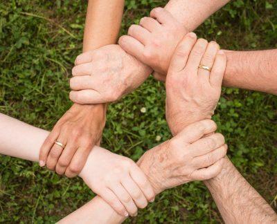 hands adults grass