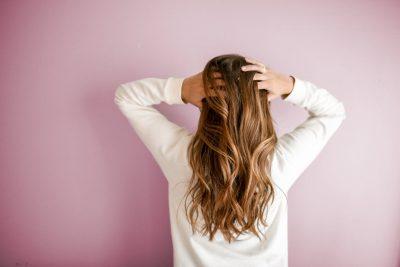 girl hair touching blonde