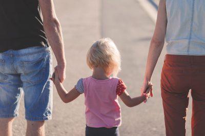 family little girl holding hands