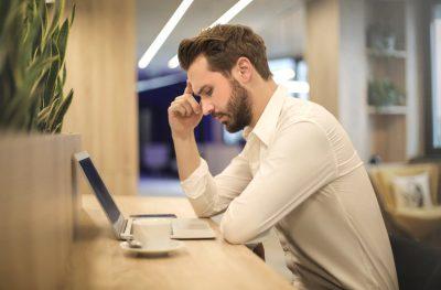 man upset at computer