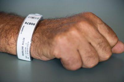 man with hospital bracelet